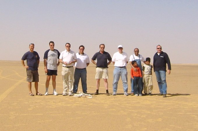 The group standing around the point with the camel bones at their feet.