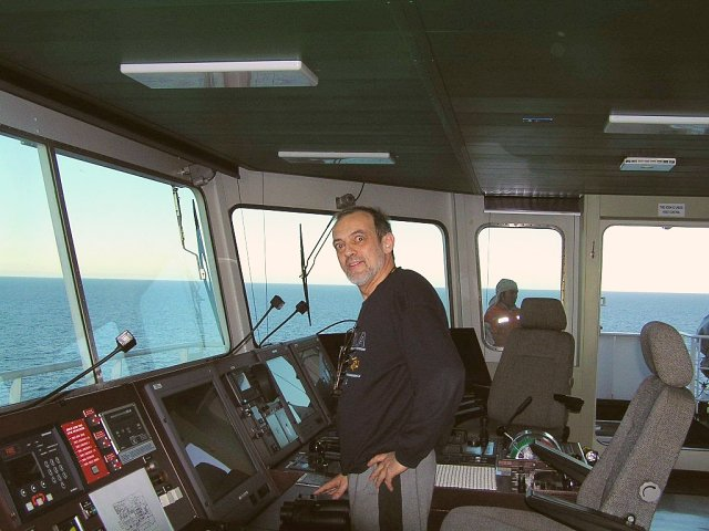 "Captain Peter on the navigating bridge of the ""Cabo Prior"""