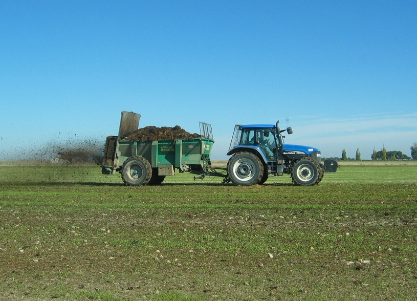 Farmer Putting Manure on his Fields