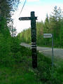 #6: Roadsigns pointing towards the spot.