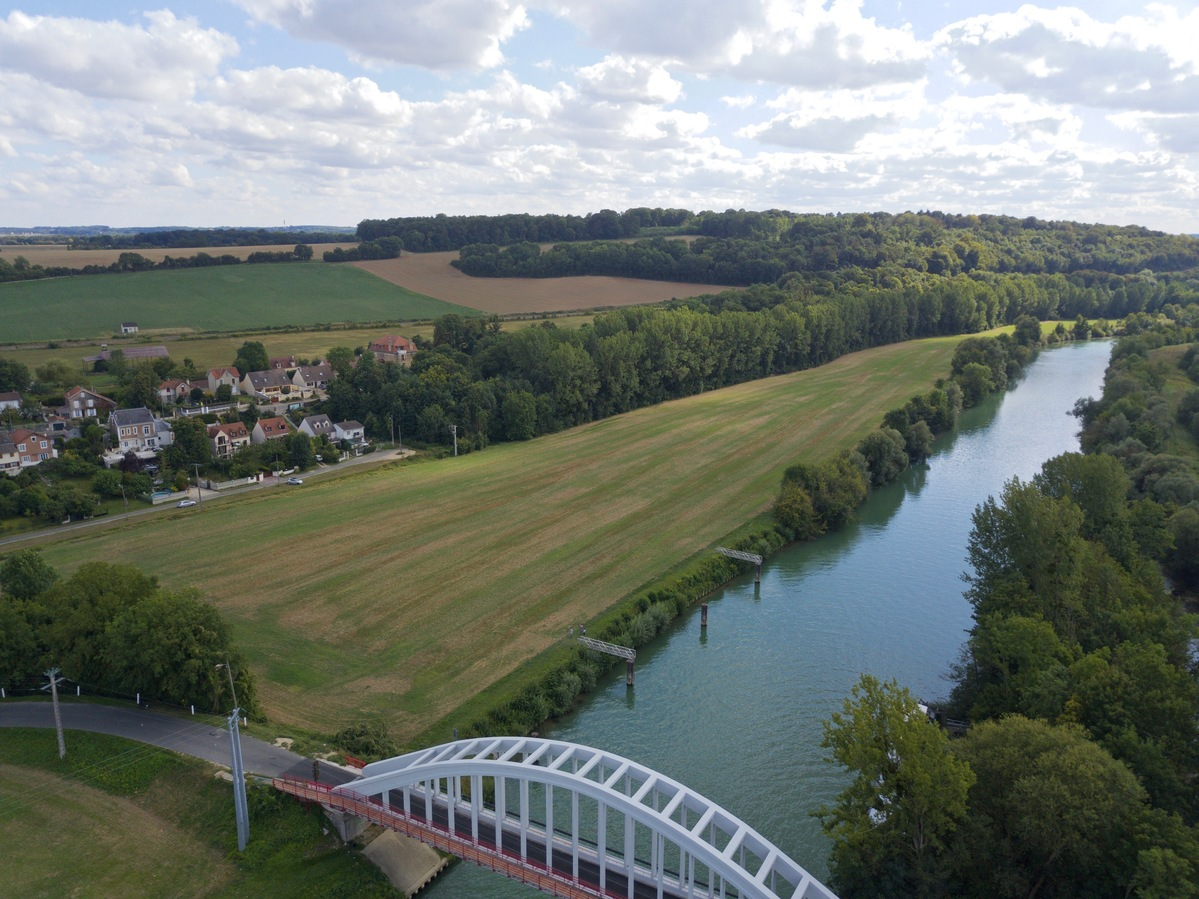 View South (across the bridge, along the Marne River), from 60m above the point