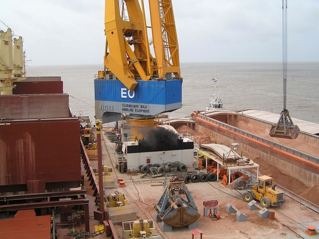 Loading bauxite at New Amsterdam, Berbice River, Guyana)