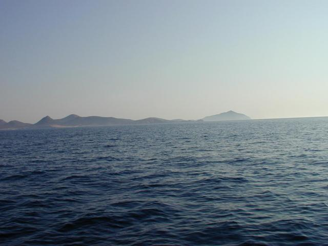 Despotikó and Strongyló (right back) islands (SW)