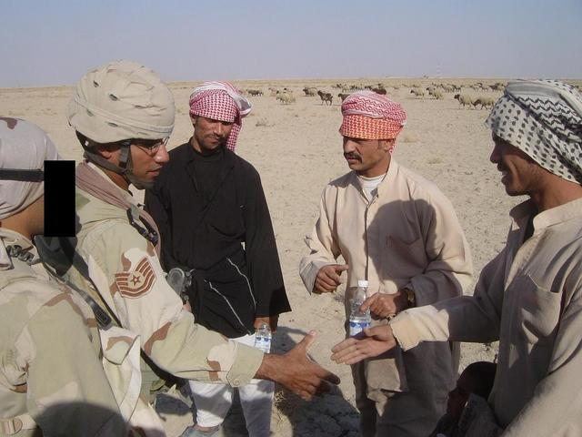 Meeting the locals (L to R, Karim & SSgt Samuel F. & local Iraqis)