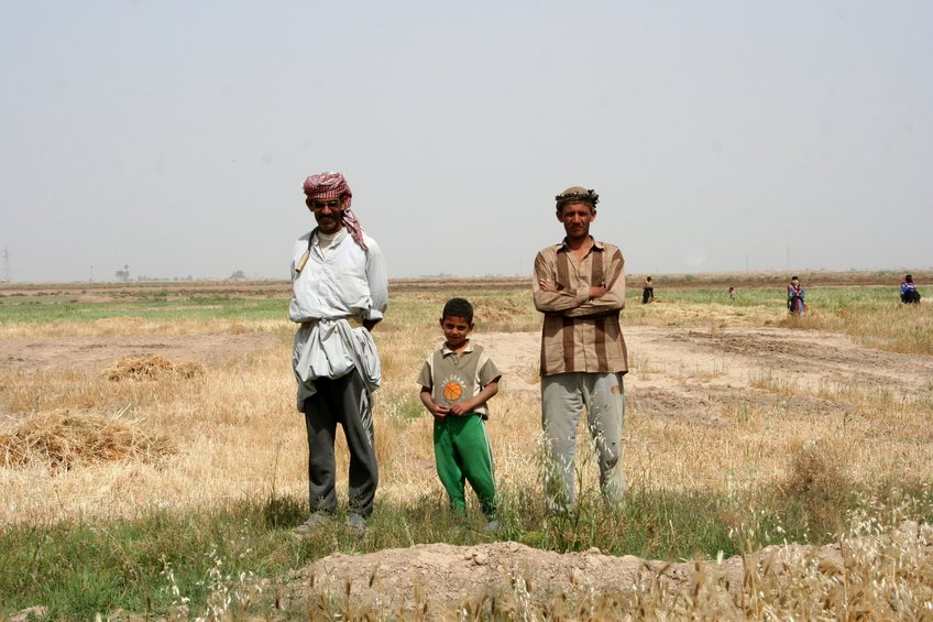 Farmer Lafta Qattaf, with brother and son