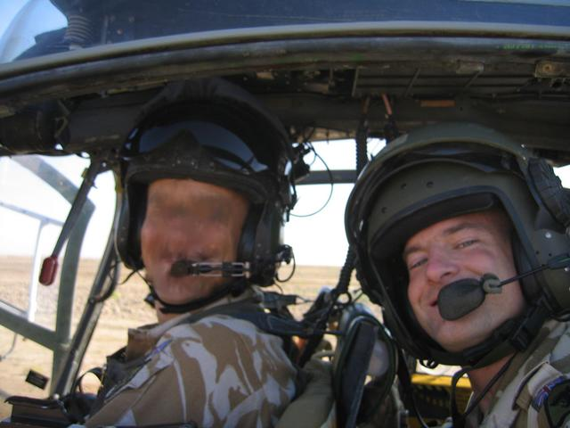 Myself with my pilot in the helicopter