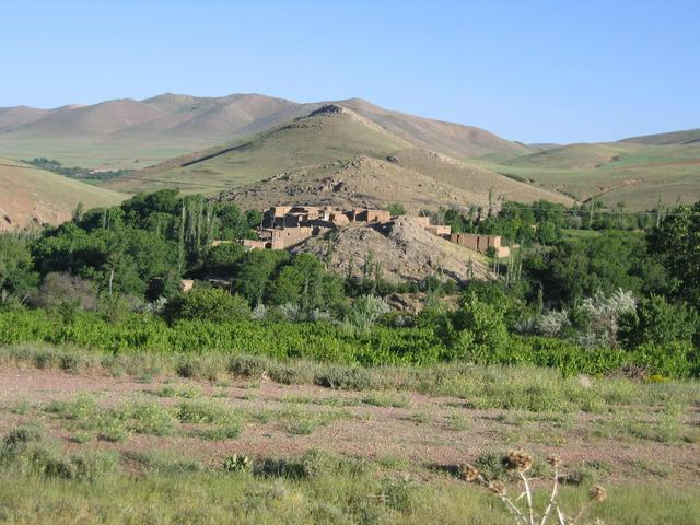 A village by the road almost 10 km east of the point