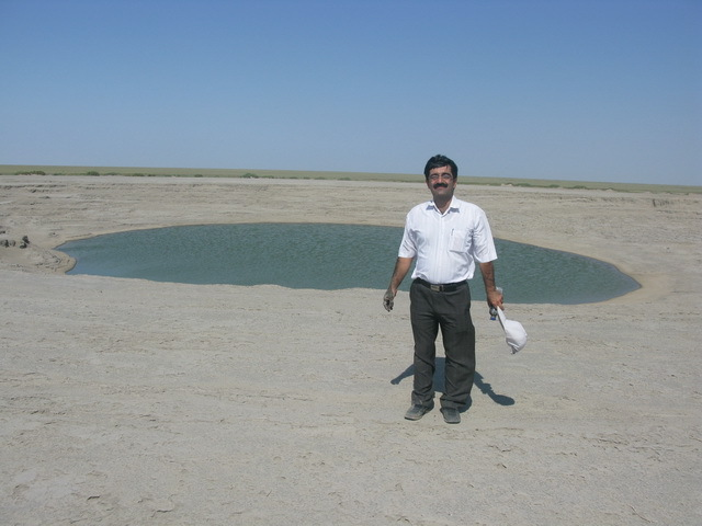 Saeed Taghinejad beside Naftijeh mud volcano