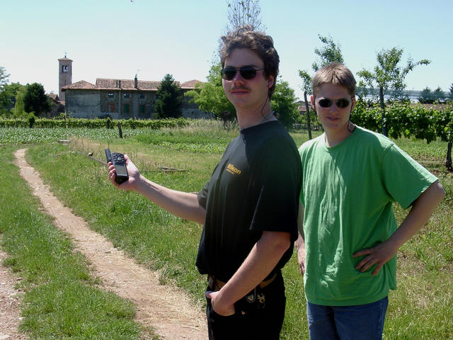Michael and Basti approaching the confluence point on the gravel way. Background: the village San Lorenzo