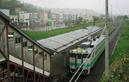 #6: Shimizuzawa station with local train in foreground and town in background.