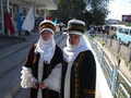 #7: two kyrgysz women in traditionell dress attending the event