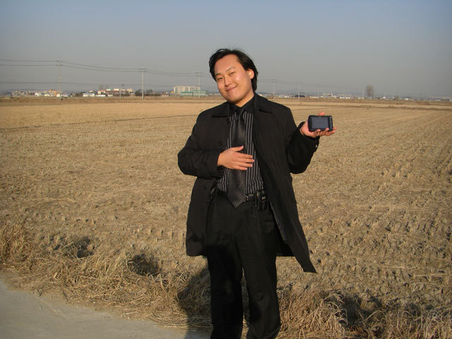 Wesley holds up the GPS navigation unit near the spot