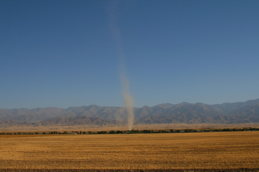 Dust devil in front of Kyrgyz Ala Too parallel to main road Tashkent - Almaty