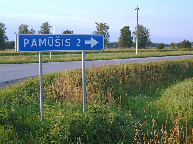 Road sign at Pamûðis, Lithuania, about three kilometres from the confluence.