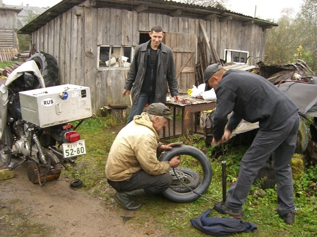 Fixing a flat tire in Russia