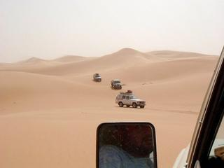 #1: Toyota convoy in the last of the dunes in a N-S crossing of the Awbāriy Sand Sea
