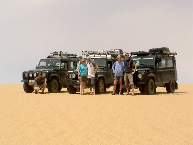 The Team in front of the Land Rovers