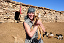 #10: Dominique with goats inside the azib