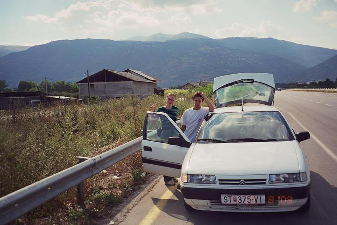 anna and daniel beside the car