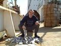 #4: Captain Peter loading fish from a Russian trawler in direct transshipment