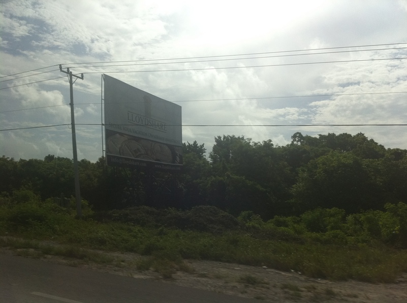 One of the many billboards on the way to the Cancun airport near the confluence.