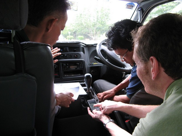 Sitoh, Jamil and I using my Windows Mobile device with GPS to find the way.