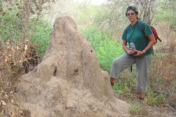 Marieta at an anthill along the hike