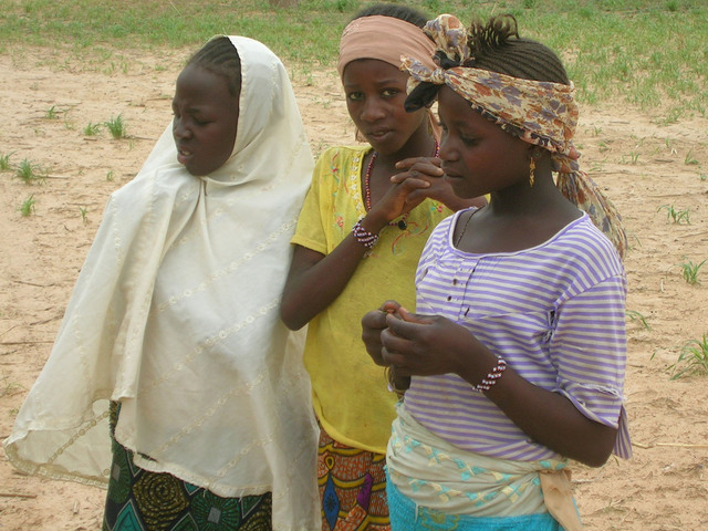 Hausa girls stop to contemplate the curious visitors
