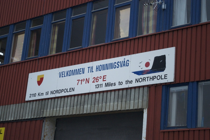 A sign in nearby Honningsvåg that notes the confluence (sort of).  (This photo was taken at midnight the previous day!)