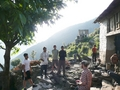 #12: The village of Naji, the closest we got to the confluence.  Manesh in white sweatshirt across on left, Mitch in plaid on right
