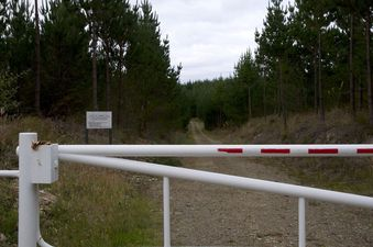 "#1: The locked forestry gate (with a ""No Trespassing"" sign), 2.75 km from the confluence point."