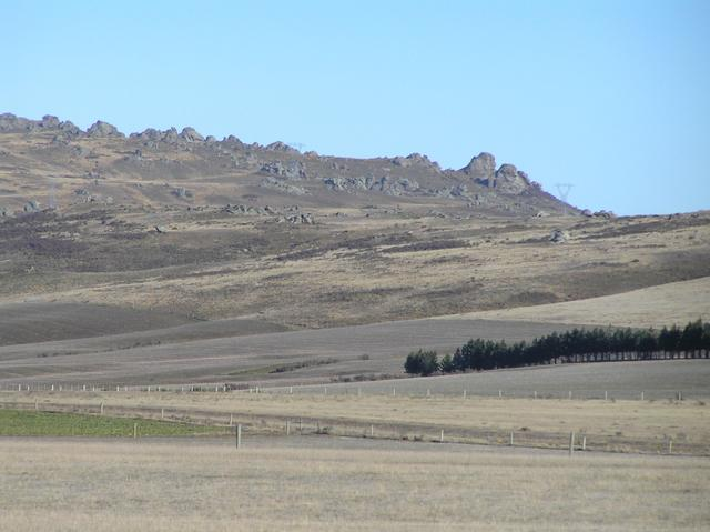 View to the east northeast from the confluence site, showing tors of schist rock in Central Otago.