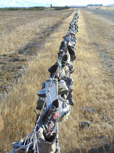 The Shoe Fence, contributed to by numerous passers-by over the years.
