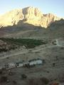 #5: Jabal Thanab with the winding road to the wādiy al-`Arabiyyīn. Also: Date palm groves.
