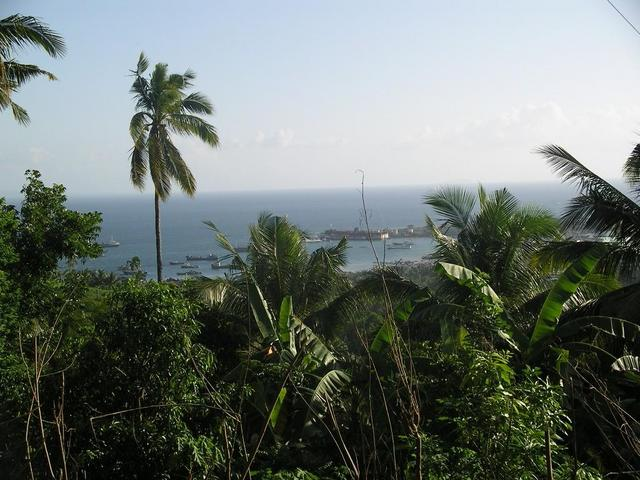 A view of Recodo located along the Caldera Bay as seen from the closest point I got to the Confluence. Note: Outline of Basilan Island over the horizon on the left side of the photo.