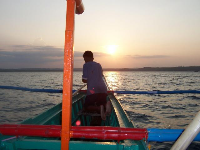 Leaving Cataingan at sunset on rented boat.