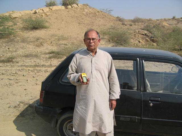 My father holding the GPS