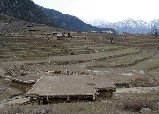 The village of Shera Kot.  The jumbles of lumber are structures destroyed in the earthquake.