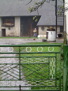#1: The confluence of N50 E019 is just behind the barn door (i.e. behind grandma in the picture) at number 99 Zlote Lany, in the village of Jankowice, Poland.