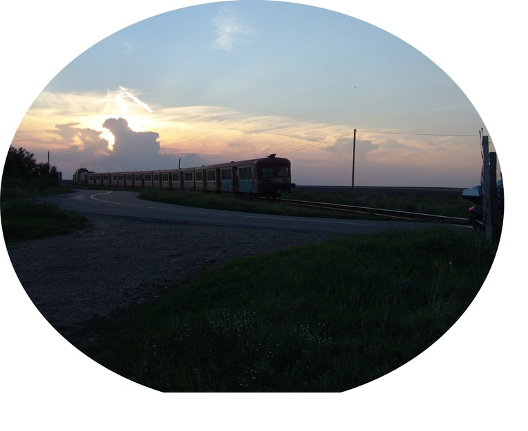 Sunset at the railroad crossing in Ketfel