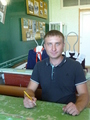 #4: Only face-on photo of our driver Evgeny acting like a classroom student in the museum of Zuyevka history