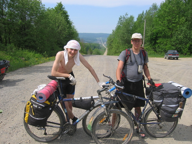 (From left:) Artem Sismekov and Ilia Yablonko. On the road Nizhniy Tagil - Serebryanka, at the Bolshoy Ural (in Russian - The Big Urals) pass on the border between Europe and Asia