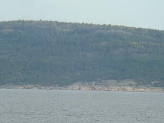 #1: Densely wooded Gogland Island seen from the Confluence