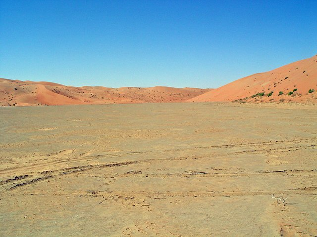 View looking west towards a relatively low saddle between dunefields. Our planned route and actual track crossed this saddle, with our maximum driving elevation reaching 358 feet (109 m).