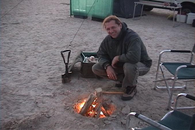 23N 52E, Marc starting up the campfire.