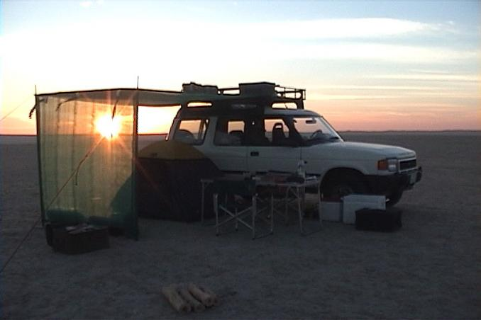 23N 52E, Sunset on camp.