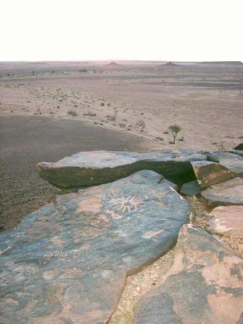 Equinox sunrise with old petroglyphs