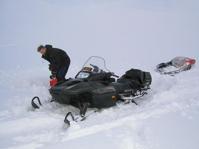 Stuck in deep snow: Digging out the snowmobile