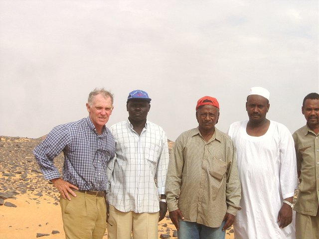 The confluence hit team at 19N 30E, Neil Munro on left, Dr Osman el-Tom 3rd from left, on an uncomfortably hot late afternoon
