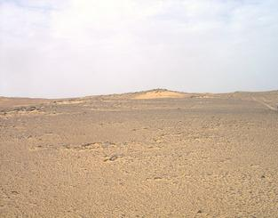#1: View of confluence site with Nubian Sandstone outcrops, loose fragments and aeolian sand